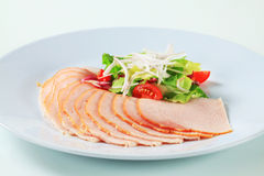 Delicately sliced chicken ham Stock Photo