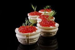 Red caviar in tartlet, isolated over black Royalty Free Stock Photo
