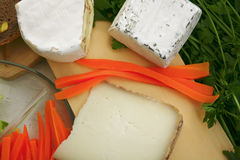 Delicatessen cheese on cut board Stock Photo