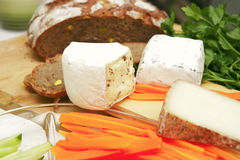 Delicatessen cheese on cut board Royalty Free Stock Photo