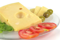 Delicatessen cheese served on dish Royalty Free Stock Photos