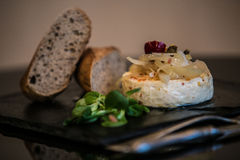Delicatessen cheese on stone plate Royalty Free Stock Image