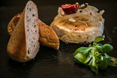 Delicatessen cheese on stone plate Royalty Free Stock Photography