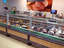 Delicatessen counter in a superstore. Royalty Free Stock Images