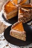 Delicatessen piece Hungarian Dobosh cake with caramel close-up. Stock Photo