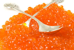 Delicatessen. Red caviar and silver spoons Royalty Free Stock Photo