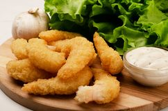 Free Delicatessen Shrimp In Breaded Closeup With Salad, Garlic And Sauce Stock Image - 131741811