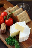 Delicatessen soft cheese with bread, tomatoes Royalty Free Stock Image