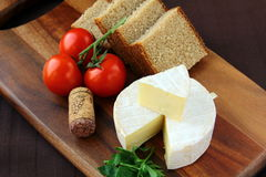 Delicatessen soft cheese with bread, tomatoes Stock Images