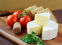 Delicatessen soft cheese with bread, tomatoes Stock Image