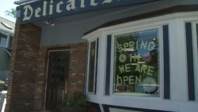 Delicatessen store front (1 of 2). A view or scene from around town stock footage