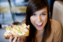 Delicious!. Young woman eating delicious waffles Stock Photos