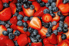 Delicious. Fresh cut strawberries and blueberries piled high and delicious Royalty Free Stock Photos