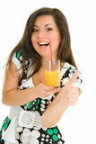 Delicious. Pretty smiling young woman with juice on white background Royalty Free Stock Image
