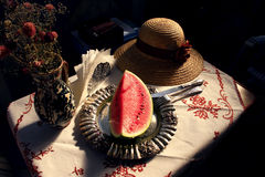 Delicious afternoon refreshment. A juicy slice of delicious watermelon rests on a silver platter. Basking in the warm light of a late summer afternoon Royalty Free Stock Image