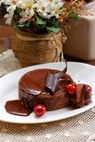 Delicious airy chocolate cherry pie. Chocolate cherry pie on a white plate with coffee stock photo