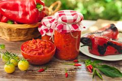 Delicious ajvar in bowl and jar Royalty Free Stock Photos