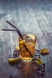 Delicious alcoholic cocktail with lemon and lime, pieces of ice royalty free stock photo