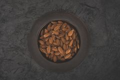 Delicious almonds on plate Stock Photo