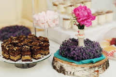 Delicious and amazing dessert table with floral decoration fudge Stock Photo