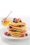 Delicious american pancakes with maple syrup and berries. Closeup of delicious american pancakes with maple syrup and berries royalty free stock images