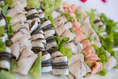Delicious appetizer canapes on board for celebratory table Royalty Free Stock Photo