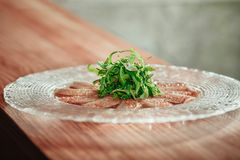 Delicious appetizer on glass plate Stock Images