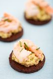Delicious appetizer of prawns on a bed guacamole Stock Images