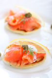 Delicious appetizer with salmon pancake Stock Photo