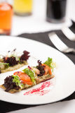 Delicious appetizer with shrimps on crispy bread Stock Photos