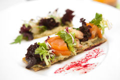 Delicious appetizer with shrimps on crispy bread Stock Images