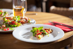 Delicious appetizer on white plate Royalty Free Stock Images