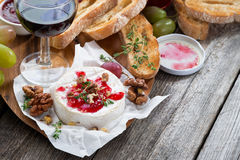 Delicious appetizers - camembert with berry jam, toast and grape Stock Photography