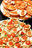 Delicious appetizers with cheese salmon and tomato Stock Images