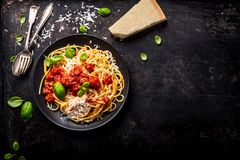 Delicious appetizing classic spaghetti pasta with tomato sauce, parmesan. Cheese and fresh basil, top view stock photos