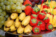 Delicious appetizing fruits. Some appetizing food at banquet table stock images