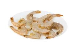 Delicious appetizing prawns on white plate on white Stock Photos