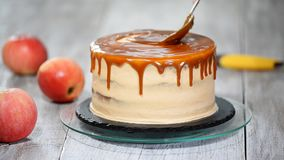 Delicious apple cake decorating with homemade caramel sauce. stock video footage