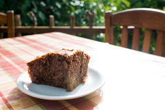 Delicious apple-chocolate cake on plate on table. Royalty Free Stock Images