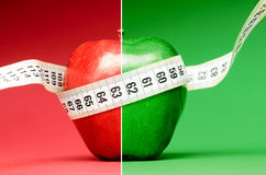 Delicious apple with measuring tape Royalty Free Stock Photos