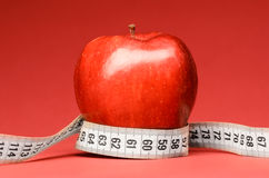 Delicious apple with measuring tape Stock Photos