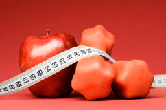 Delicious apple with measuring tape Royalty Free Stock Image