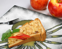 Delicious apple-pie. Piece of delicious apple-pie decorated apple slices and coco icing Stock Photos