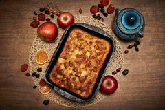 Delicious Apple pie baked at home. Sweet pie stuffed with apples. Apple cake on the table, culinary skills. Favorite dish Royalty Free Stock Photography