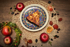 Delicious Apple pie baked at home. Sweet pie stuffed with apples. Apple cake on the table, culinary skills. Favorite dish Stock Photos