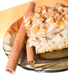 Delicious apple pie on a plate with cinnamon. Stock Photos
