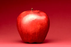 Delicious apple on red Royalty Free Stock Image