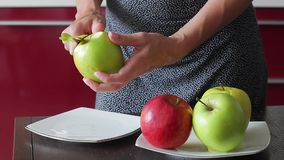 Delicious apples lay on a plate. stock video