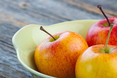Delicious apples in a yellow bowl Stock Photo