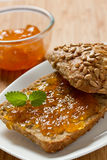Delicious apricot jam on the bread Stock Photo